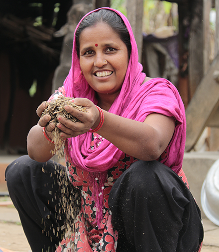 Bindu separates fodder seeds to feed her livestock.