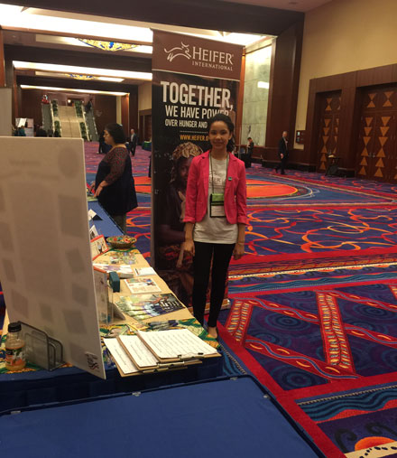 Amy John-Terry staffing an Educator's Conference on behalf of Heifer International