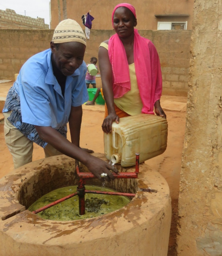 Mamadou and Yacine feed their biogas digester.