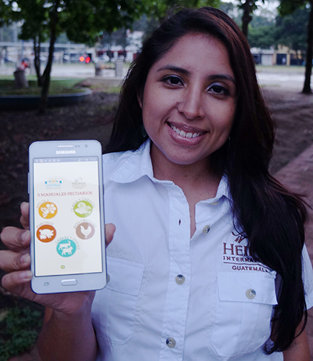 Debora Martinez shows off Heifer Guatemala's award-winning app.