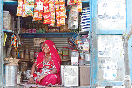 Panna Devi tends to her shop