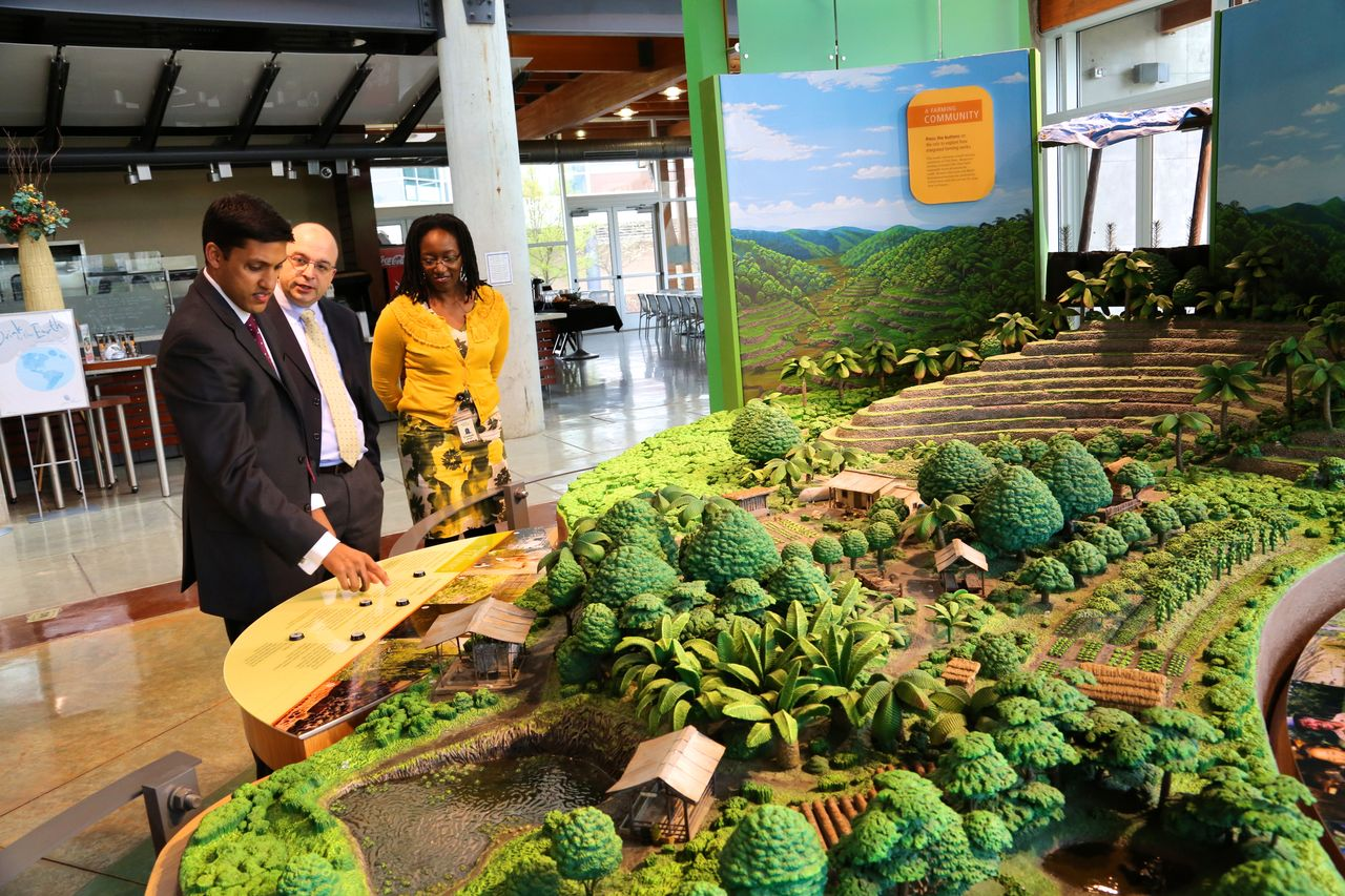 Dr. Raj Shah, USAID Administrator, reviews Heifer Village's integrated farming model. He was escorted by Pietro Turilli, Vice President for Partnerships and Business Development and Elizabeth Bintliff, Vice President for Africa Program